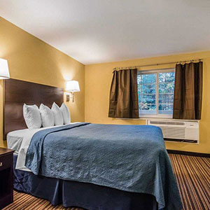 photo of single guest bed in hotel room